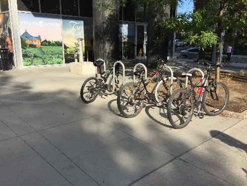 Bike parking in the form of a wave allows you to lock your bicycle frame and wheel.
