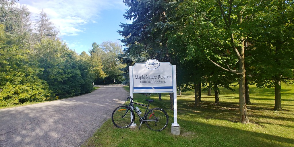 Bike in front of conservation area sign