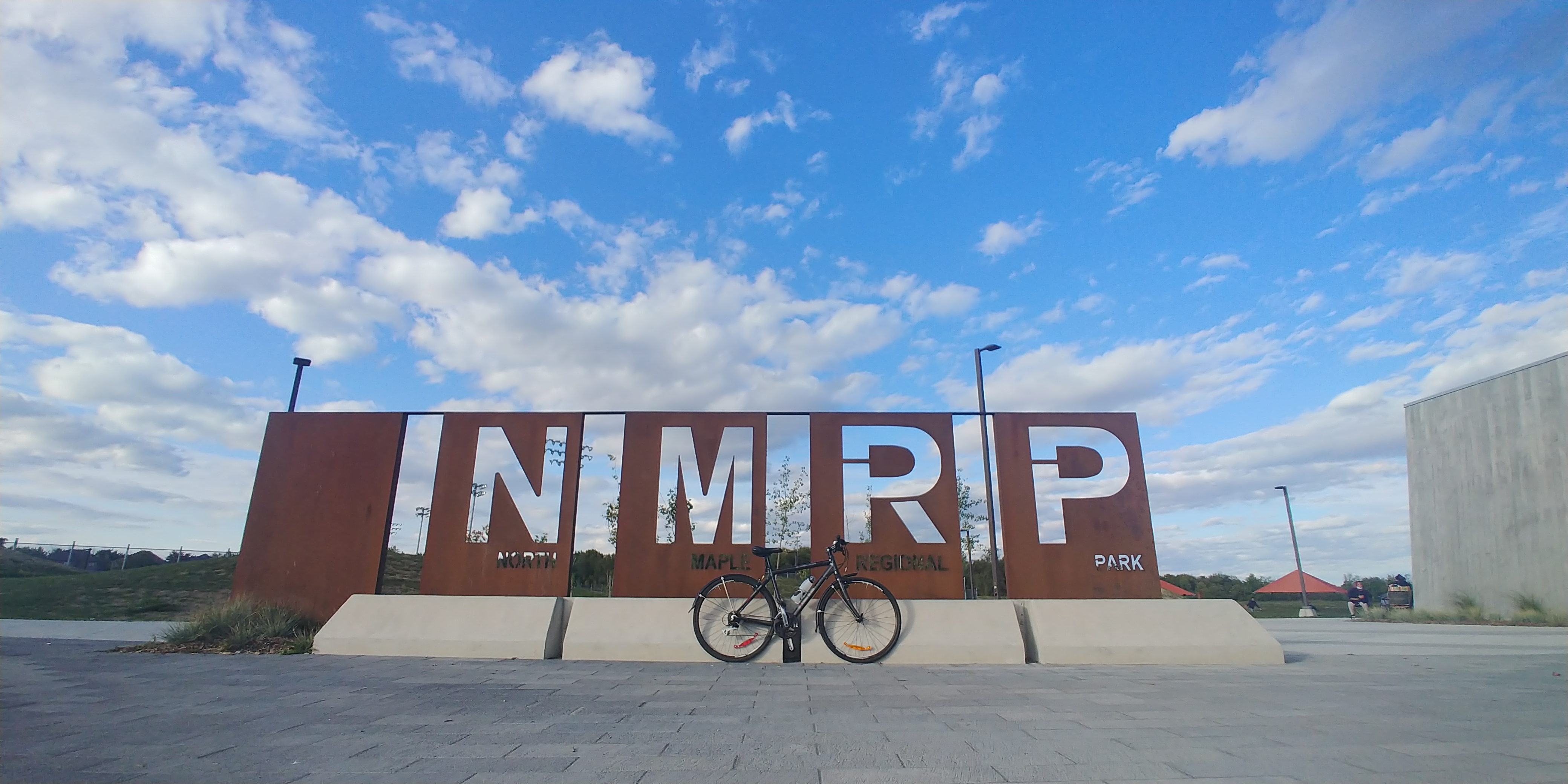 Bicycle in front of North Maple Reserve Park sign
